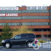 Large banners for advertising For Lease Space on Spokane Valley buildings by Signs for Success
