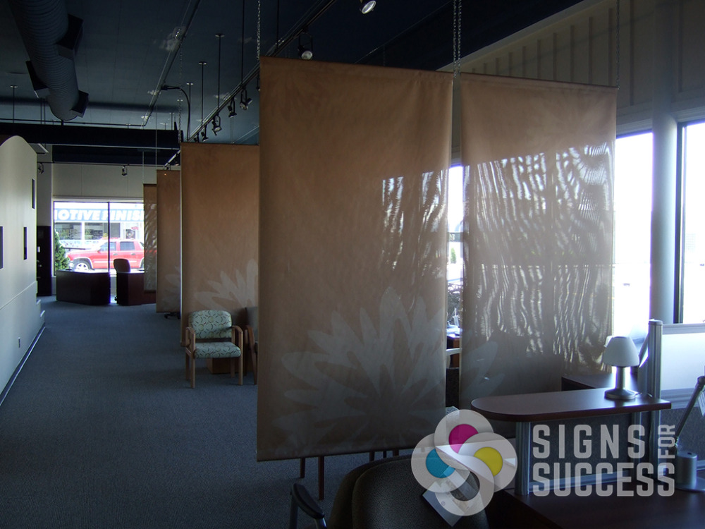 When Contract Design Associates in Spokane needed desk separation without blocking all the light, we used these mesh banners, double sided to create a great backdrop wall
