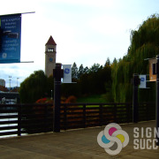 Advertise your event with pole banners, like these showing Spokane's Riverfront Park Clock Tower
