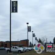 Decorate your High School with beautiful, bright pole banners, done fast by Signs for Success in Mead and Deer Park
