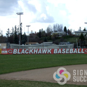 100 foot banner for Blackhawk Baseball in Cheney on mesh banner, sponsored by ARMY, printed by Signs for Success in Spokane
