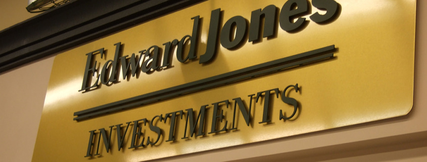 We get lots of comments on this lobby sign for Edward Jones, laser cut acrylic dimensional letters mounted to brushed gold background, hung on the wall, by Signs for Success in Spokane, call now for fast service
