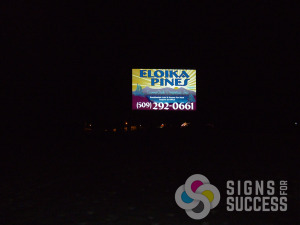 Eloika Pines reflective sign at night, custom reflective signs