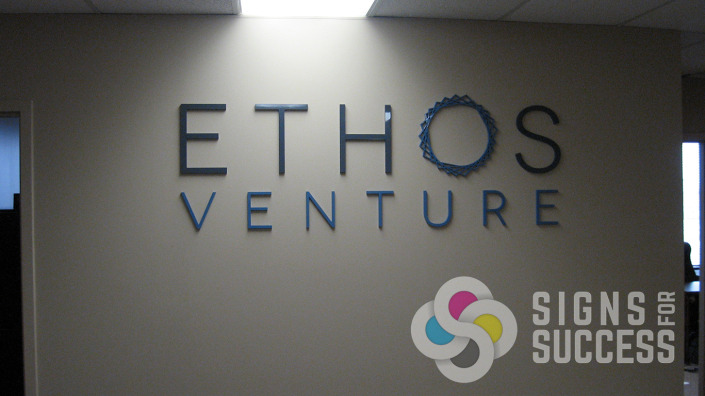 Ethos lobby sign of laser cut acrylic letters and logo, adds a classic look to the office wall, by Signs for Success, fast service, reliable now in Spokane