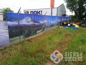 You can even hide the mess next door with custom printed chain link privacy slats like this Spokane Business did, by Signs for Success, call now for a fast, free quote
