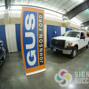 Retractable popup banner stand for Gus Johnson Ford at Spokane trade show, get yours now from Signs for Success fast