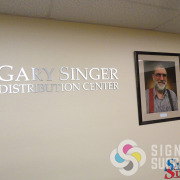 Aluminum dimensional letters for lobby or memorial lettering, like these for Gary Singer Distribution Center at 2nd Harvest to honor a long time volunteer