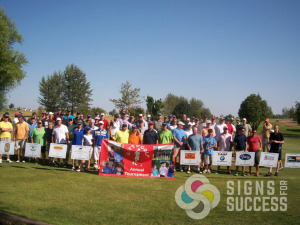 Advertisers and sponsors with banners at Gift of Golf Tournament in Post Falls and Cheney