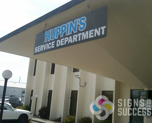 A building projecting sign or hanging sign will work for your business, Signs for Success can provide that sign for you