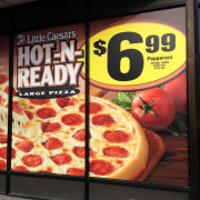 Add your advertisement to your windows with a custom printed window wrap. Signs for Success can design, print, install for you like this one of Little Caesars Pizza