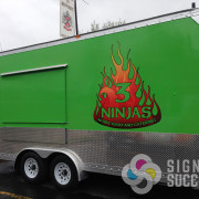 3 Ninjas had an awesome green trailer food truck, but wanted a custom logo that advertised for them, Signs for Success did this custom graphic, and printed and cut and installed in Spokane