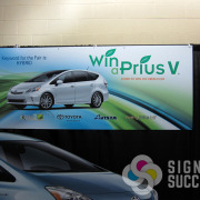 Win a Toyota, sponsored by Avista and Krem2 TV, backdrop for tradeshow display, printed fast by Signs for Success, Spokane