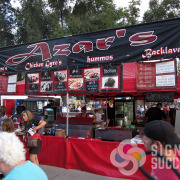 Various banners for menu items, pricing, and logo name for Azar's, a food concession at many street fairs and events