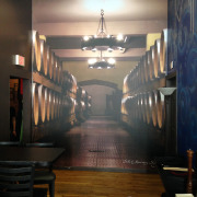 This wall wrap printed on vinyl decal for Downtown Spokane Restaurant and Bar adds dimension to a smaller room with a perspective of a winery, vinyl wall wraps