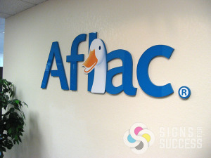 Aflac needed a dimensional logo for their lobby sign, and Signs for Success was able to provide laser cut acrylic with digitally printed Aflac duck added to the face, Spokane looks great now with Aflac signs