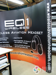 this trade show backdrop popup display for EQ1 Wireless was designed and printed by Signs for Success, Spokane, for fast signs now, trade show displays spokane