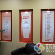 Indoor posters with lighting, hanging to look dimensional by signs for Success in Spokane for YWCA