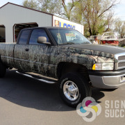 John's matte black and camouflage wrap on Dodge pickup truck