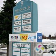 Kidds Dental in North Spokane and Spokane Valley needed a wrap around banner for this monument sign as temporary signage until their big sign went in