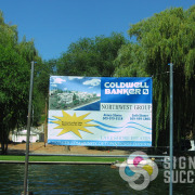 Realtors can use banners for waterfront or large properties, like this Coldwell Banker mesh banner for LakeShore Estates in Deer Park and Spokane