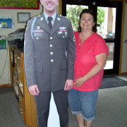 "Have your millitary servicemember ""stand in"" on family portraits with a life-sized, free standing, full sized cutout of the person who is absent, done locally in Spokane, WA"
