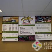 Fixed menu pricing with area that is laminated with Graffiti free laminate for writing on like this one for Scrum Diddly Umptious Donuts, Spokane