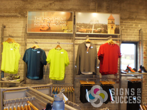 Decorate with affordable styrene, paper, foamcore signs, gator posters in your retail clothing store, by Signs for Success in Spokane