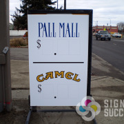 This convenience store had a sidewalk sign frame and Signs for Success was able to make new faces for it in Spokane