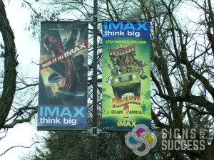 IMAX, think big, pole banners for new movies at Riverfront Park by Signs for Success