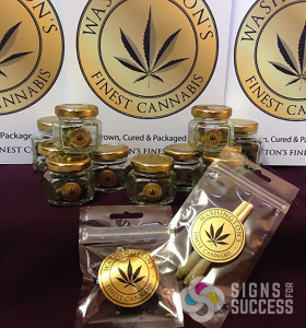 These foiled roll custom labels were printed on paper stock gold foil for Washington's Finest Cannabis, also Clear stickers decals for windows and styrene table signs round out the products, custom labels