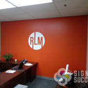 "Real Life Ministries Spokane has their ""orb"" logo on office wall, by Signs for Success"