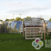 Custom print of a high resolution landscape decorate this daycare fencing and give privacy with Chain Link Fence Slats by Signs for Success