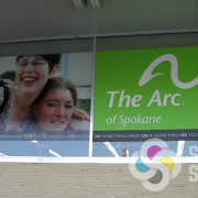 Wrap your windows with advertising for a great look, temporary or permanent vinyls like these for The Arc in Spokane