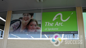 Wrap your windows with advertising for a great look, temporary or permanent vinyls like these for The Arc in Spokane, environmental window graphics