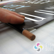 Finishing interior pole banner to fit dowel for Spokane Transit, done fast by Signs for Success