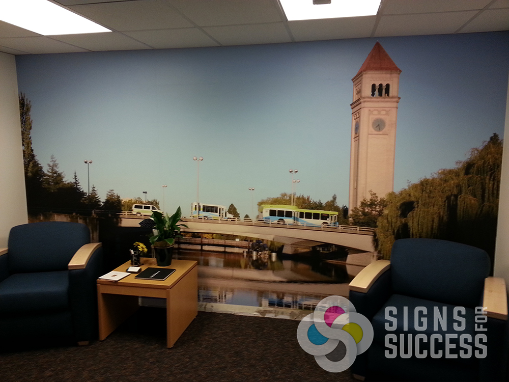 ... Spokane Transit new office lobby wall wrap with Spokane mural showing Clock Tower and busses, ...