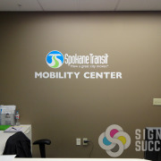 Printed and cut high performance vinyl stickers are on the wall at Spokane Transit Mobility Center, printed, laminated, cut, installed by Signs for Success