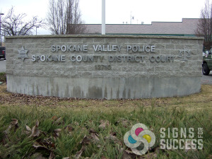 dimensional letters Spokane Valley District Court wanted aluminum metal letters with lifetime warranty for this curved block wall, dimensional letters by Signs for Success, call now for fast service