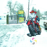 This life-sized cutout of Santa on a Motorcycle attaches to a post, with one on each side, this draws the eye and gets attention with custom standees