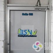 Scanning Services NW needed to block some visibility with perforated window vinyl sticker decal, digitally printed on this door. They can see out, but you cannot see in when it's brighter on the outside