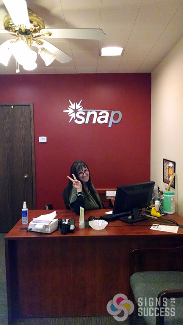 snap had a new logo and wanted metal laminate dimensional letters on their entrance office lobby