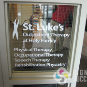 Cut white vinyl for office windows and hours can have impact for information, advertising, wayfinding like St. Lukes Outpatient in Spokane