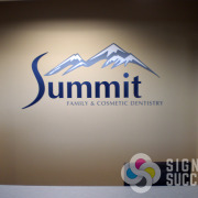 Printed and cut vinyl on wall is more affordable than dimensional letters and still looks great, like this for Summit Family & Cosmetic Dentistry Spokane