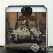 Garage door Wraps is something we do at Signs for Success, Spokane, like this image of a tank, call now