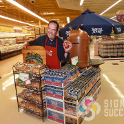 Life Sized Standee for grocery store advertising shows Tom Sherry at Spokane Trading Co Stores, cut out of Styrene, Gator, or Coro, free standing coroplast signs spokane valley
