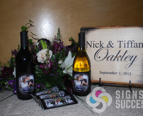 The next wedding or event, call Signs for Success for custom wine bottle labels, candy bar wraps, plank art printing as attendant gifts, and lots more ideas in Spokane