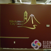 Lobby sign of brushed metal dimensional aluminum letters and logo in Spokane for Windermere City Group
