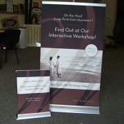 Small desktop retractable, medium tabletop retractable banner stand for Wolf & Associates, Spokane