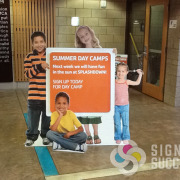 "Cut out corrugated plastic ""coro"" standees for intriguing life-sized cutouts of kids for Spokane and Spokane Valley YMCA locations"