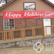 Happy Holidays message from Designers Edge is put up each year in Spokane, and easy to store the rest of the year
